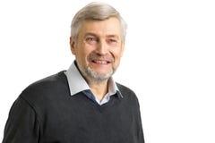 Smiling mature man close up. Portrait of elderly white-skined man smiling on white background Royalty Free Stock Photos