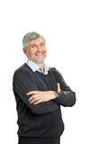 Smiling mature man with crossed arms. Royalty Free Stock Photo