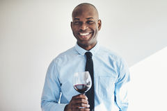 Smiling mature man drinking a glass of red wine Royalty Free Stock Image