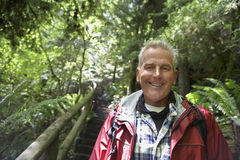 Smiling Mature Man In Forest. Closeup portrait of a smiling mature man in forest Royalty Free Stock Image