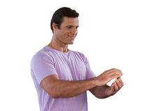 Smiling mature man gesturing. While standing against white background Stock Images