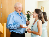 Smiling mature man giving jewel to woman Royalty Free Stock Photo