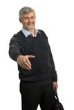 Smiling mature man with greeting gesture. Senior confident man offering to shake the hand isolated on white background Stock Images