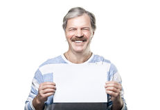 Smiling mature man holding a blank billboard. Isolated on white background Stock Photography
