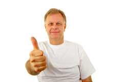 One Thumb Up. Smiling mature man holding one thumb up Royalty Free Stock Photography