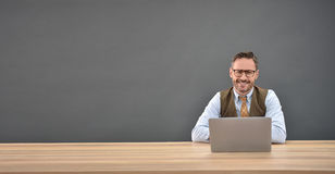 Smiling mature man on laptop Stock Photo