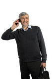 Smiling mature man with phone. Happy mature man speaking on phone on white background Stock Image