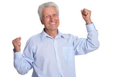 Smiling mature man. Portrait of a smiling mature man posing against white Stock Photos