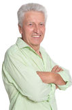 Smiling mature man. Portrait of a smiling mature man posing against white Royalty Free Stock Photos