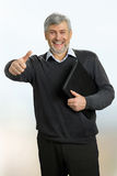 Smiling mature man raised thumb up. Happy and smile senior man raised his thumb up. Gesture everything is okay Stock Images