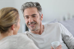 Smiling mature man talking to his wife Royalty Free Stock Photo