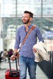 Smiling mature man traveling with suitcase Royalty Free Stock Photos