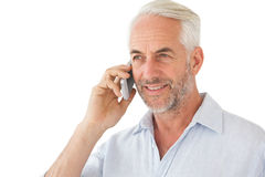 Smiling mature man using mobile phone Stock Photography