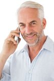 Smiling mature man using mobile phone Stock Photos