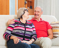 Smiling mature man with  wife in home Royalty Free Stock Image