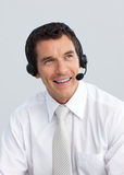 Smiling mature man working in a call center Stock Photo