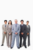 Smiling mature salesman standing together with his team Royalty Free Stock Photo