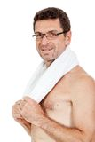 Smiling mature sporty man with towel fittness sport health isolated. Mature sporty man with towel fittness sport health isolated on white Stock Photography