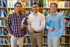 Smiling mature students together in the library Royalty Free Stock Image