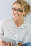 Smiling mature woman in casual clothes with tablet Stock Images
