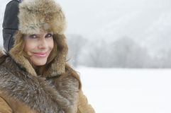 Smiling Mature Woman In Coat And Fur Cap Royalty Free Stock Photos