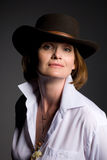 Smiling mature woman a cowboy hat Royalty Free Stock Images