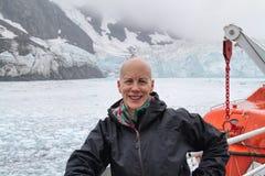 Smiling mature woman, cruise glaciers icebergs Stock Photos