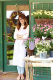 Smiling Mature Woman Florist  At Flower Shop Stock Images
