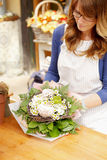 Smiling Mature Woman Florist  At Flower Shop Stock Photo