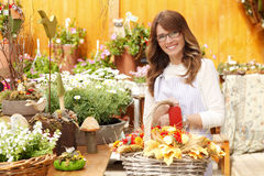 Smiling Mature Woman Florist  At Flower Shop Royalty Free Stock Image
