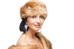 Smiling mature woman in fur isolated on white Stock Photo