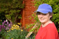 Smiling mature woman in garden Stock Photos