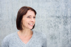 Smiling mature woman in gray sweater Stock Photo