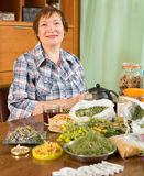 Smiling mature woman with  herbs Stock Photo