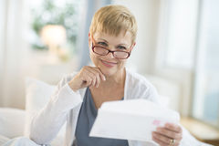 Smiling Mature Woman Holding Envelope Stock Photos