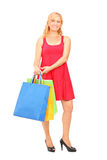 Smiling mature woman holding shopping bags Stock Photos