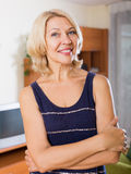 Smiling mature woman  in home or office Royalty Free Stock Photography