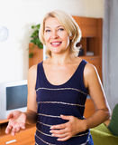 Smiling mature woman in home or office Stock Photography