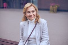 Smiling mature woman looking somewhere Stock Image