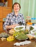 Smiling mature woman with medicinal herbs Stock Photos