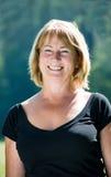 Smiling mature woman outdoor portrait Stock Image