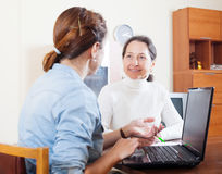 Smiling mature woman questionnaire for  social worker Stock Photography