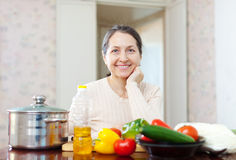 Smiling mature woman with  vegetables Royalty Free Stock Images