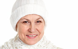 Smiling mature woman in winter cap Stock Photo