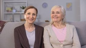 Smiling mature women posing for camera, high quality of retirement people living. Stock footage stock footage