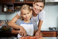 Mother teaching daughter how to cook royalty free stock photography