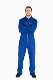 Smiling mechanic in boiler suit. Against a white background royalty free stock photos