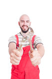 Smiling mechanic holding an adjustable wrench Stock Image