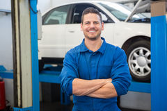 Smiling mechanic looking at camera Royalty Free Stock Photography