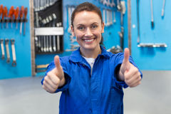 Smiling mechanic looking at camera Stock Photo
